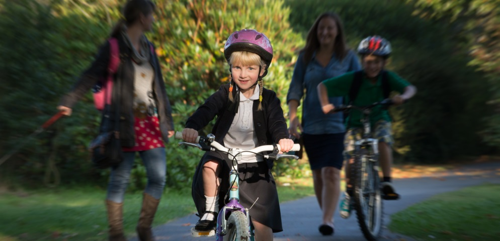 Girl cycling to school