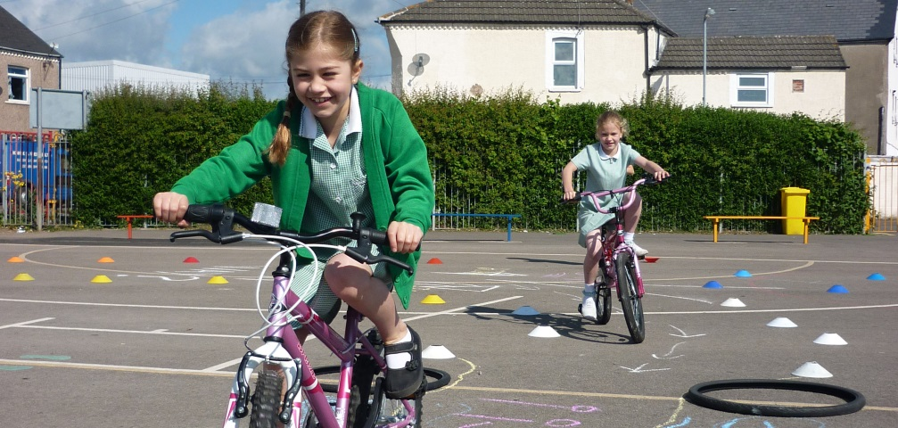Girls cycling on playground